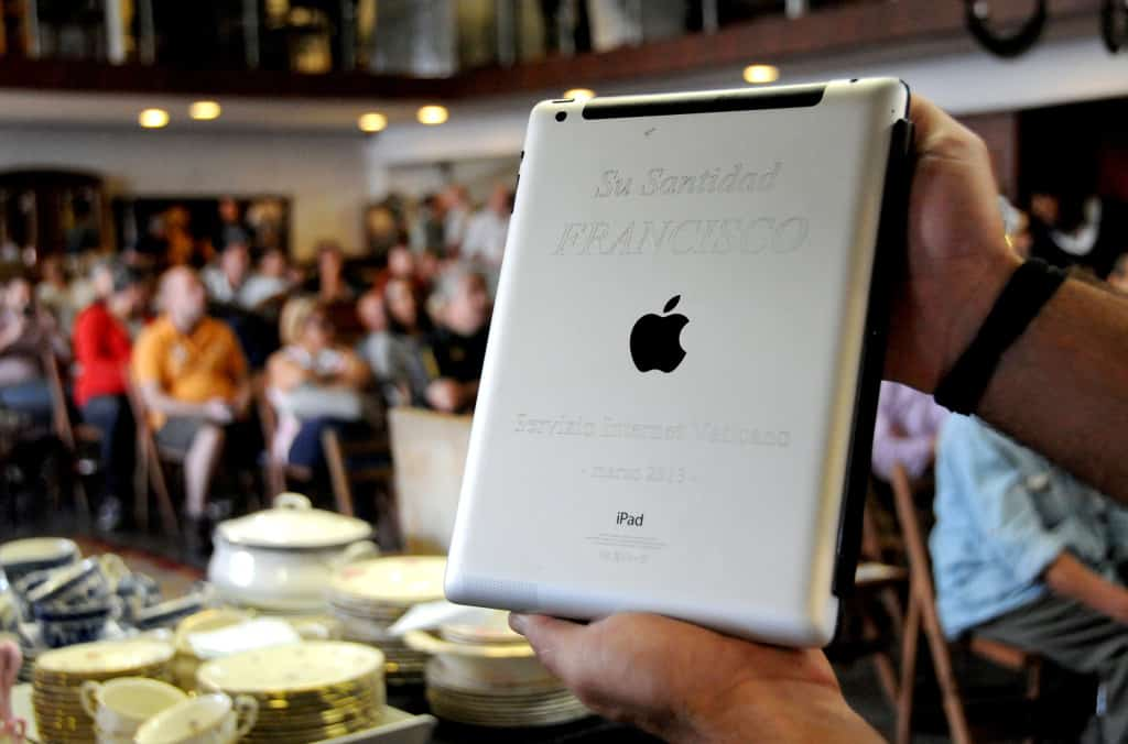 Image: An Apple iPad which belonged to Pope Francis is seen at Castells auction house in Montevideo