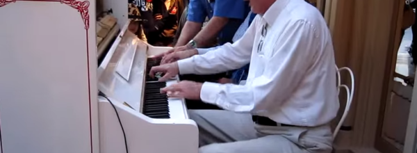 Disneyland Employee Is Joined By Two Random Guests In This Amazing 5-Handed Piano Jam