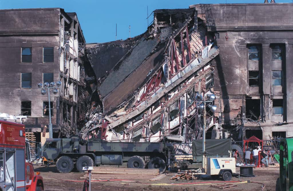 010912-D-9880W-073 View of the west-facing wall of the Pentagon on the late afternoon of Sept. 12, 2001. Approximately 30 hours earlier, hijacked American Airlines Flight 77, a Boeing 757 with 64 passengers aboard was purposely crashed into this spot in an act of terrorism.  DoD photo by R. D. Ward.  (Released)
