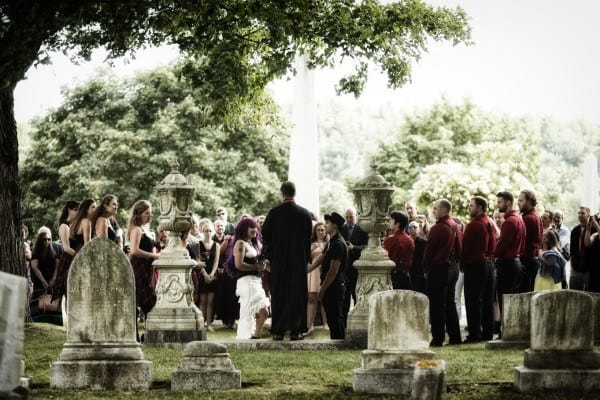 Bronwyn Gauvin and Zack Bridgham exchange wedding vows Saturday in a goth-themed wedding at Mount Hope Cemetery.