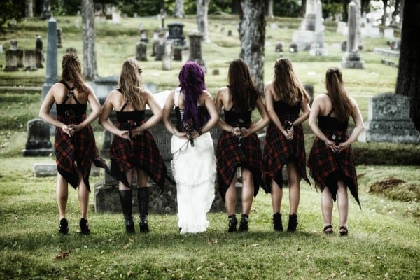 Bride Bronwyn Gauvin and her bridesmaids poses Saturday at Mount Hope Cemetery.