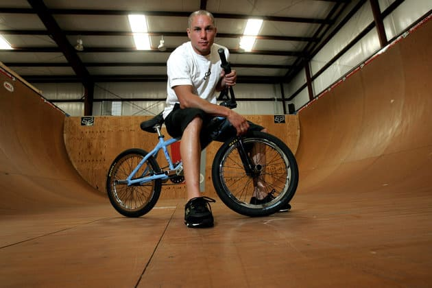 ** ADVANCE FOR WEEKEND EDITIONS, JULY 9-11 ** X-Games athlete Dave Mirra poses in the half-pipe at his training facility in Greenville, N.C. Friday, June 24, 2005. Mirra clearly enjoys his life these days, and who could blame him? He's one of the featured stars of a national action sports tour and the host of a reality show on MTV, and he soon will be married. (AP Photo/Gerry Broome)