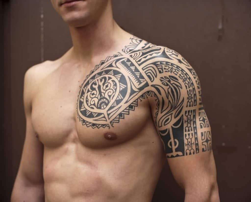Superb-Polynesian-Tribal-Tattoo-On-Left-Chest-And-Shoulder-For-Men