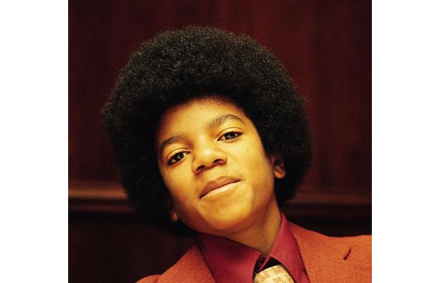 the-face-of-a-young-michael-jackson-as-he-appeared-in-the-era-of-the-jackson-5-and-their-discovery-at-the-famous-apollo-theatre-in-harlem