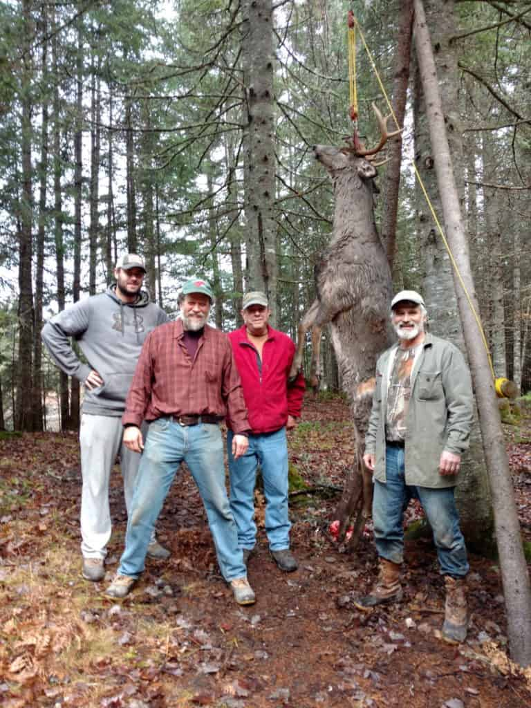 "The ""drag team"" -- Joe Keith of Somerville, Massachusetts (left), Bruce Crawford of Kittery, Kip Paules of Bowdoinham, and Dave Norsworthy of Bangor pose with the 267-pound, 9-point buck that Paules shot in the Allagash on Nov. 19. (Thom Thomas photo)"