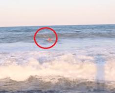 lifeguard saves people riptide
