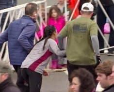 marathon help woman finish