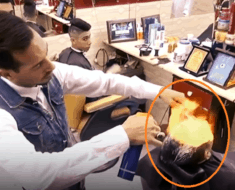 barber uses fire on hair