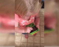 little girl gameboy swiping