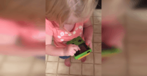 little girl gameboy swiping