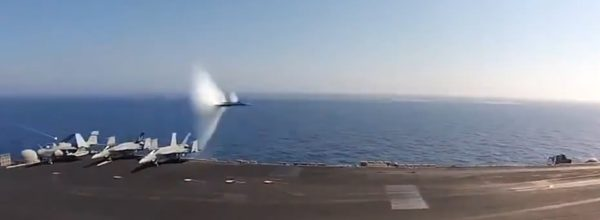 U.S. Navy Jet Breaks Speed Of Sound Flying Past Aircraft Carrier At Supersonic Speed