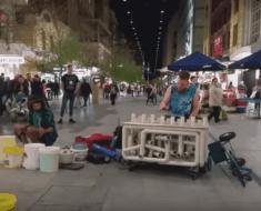 pipe guy techno hobo street performance