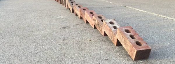 Man Demonstrates The Super Cool 'Double Domino' Effect Using Bricks