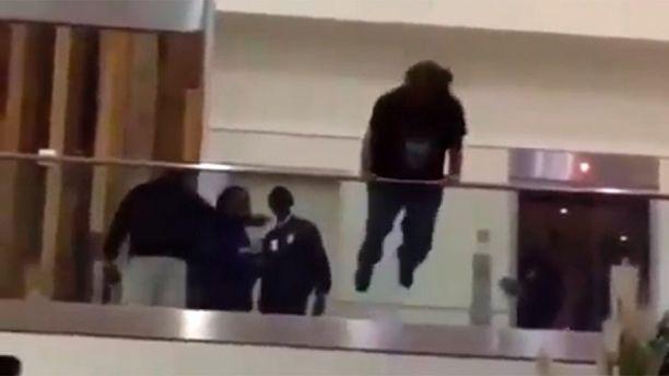 atlanta airport man jumps