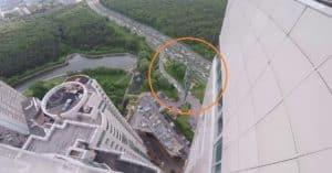 glass falls from top skyscraper