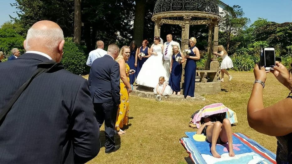 Sunbathing Woman Refuses To Move Out Of Couple's Wedding Photos